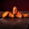 Neben Burgern bietet Burger Palace auch lecker Chicken Wings an